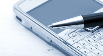 business tasks and pen on a mobile phone